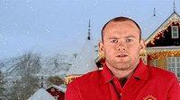 Wayne Rooney se psem ve vánoční reklamě.