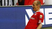 Fotbalista Bayernu Mnicho Arjen Robben oslavuje svůj gól v utkání proti Wolfsburgu.