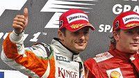 V Belgii ještě závodili Giancarlo Fisichella (vlevo) a Kimi Räikkönen proti sobě, od závodu v Monze z nich budou týmoví parťáci.