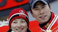 Čínští vítězové na mistrovství světa v akrobatickém lyžování.
