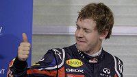 Spokojený Sebastian Vettel po kvalifikaci na GP Abú Zabí. Německý pilot získal 14. pole position v sezóně a vyrovnal letitý rekord Nigela Mansella.
