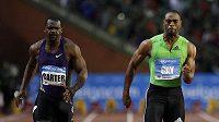 Američan Tyson Gay (vpravo) vítězí v běhu na 100 před jamajským sprinterem Nestou Carterem na bruselském Memoriálu Van Dammeho.