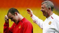 Zraněný Wayne Rooney (vlevo) chybí trenérovi Fergusonovi a celému Manchesteru United víc, než si všichni připouštěli.