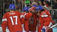 Čeští hokejisté se radují po jedné z branek do lotyšské sítě v osmifinále olympijského turnaje.