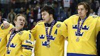 Švédštím hokejisté se radují ze třetího místa na MS dvacítek.