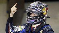 Sebastian Vettel. Vyhrál v Abú Zabí a raduje se z titulu mistra světa.