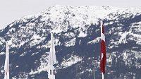Lotyšský čtyřbob pilotovaný Janise Mininsem v olympijském kortytu