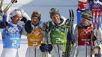 Po vítězství ženské běžecké štafety Švédska zvítězila i ta mužská. Zleva Marcus Hellner, Johan Olsson, Daniel Richardsson a Lars Nelson