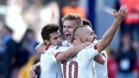 Michal Trávník, Martin Frýdek a Jiří Skalák oslavují čtvrtý gól během utkání proti Srbům