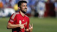 Španělský útočník David Villa slaví gól v přípravném zápase proti Salvadoru.