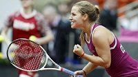 Slovenská tenistka Dominika Cibulková se raduje z výhry nad Ruskou Anastázií Pavljučenkovou.