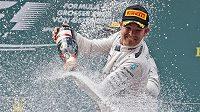Německý pilot Nico Rosberg slaví vítězství ve Velké ceně Rakouska.