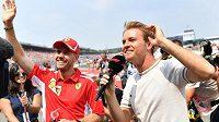 Sebastian Vettel a Nico Rosberg.