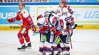 Hokejisté Pardubic (zleva) Tomáš Rolinek, Rostislav Marosz, Marek Hovorka a Jacob Cardwell oslavují gól na 1:0 během utkání Tipsport extraligy na ledě Sparty.