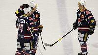 Chomutovští hokejisté zleva Tomáš Bartejs, Michael Frolík a Jakub Trefný se radují z gólu Budějovicím.