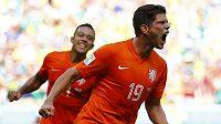 Nizozemec Klaas-Jan Huntelaar se raduje z proměněné penalty proti Mexiku v osmifinále MS.