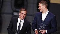 Obránce Bayernu Philipp Lahm (vlevo) a brankář Manuel Neuer se vešli mezi nejlepší jedenáctku uplynulého roku.