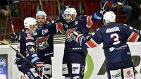 Hokejisté Chomutova (zleva) obránce Petr Šidlík, útočníci Michal Vondrka a Vladimír Růžička a zadák Adam Jánošík se radují z gólu proti Karlovým Varům.