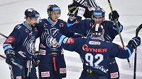 Liberečtí hokejisté (zleva) Jakub Valský, Michal Bulíř a Petr Jelínek se radují z gólu v Mladé Boleslavi.