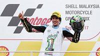 Italský jezdec Marco Morbidelli slaví titul mistra světa ve třídě Moto2 po Velké ceně Malajsie na okruhu v Sepangu.