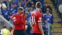 Zklamaní fotbalisté Manchesteru United Wayne Rooney (vlevo), Adnan Januzaj (uprostřed) a Robin Van Persie během zápasu v Leicesteru.