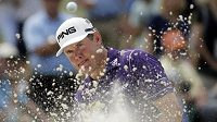 Lee Westwood, of England, hits out of a bunker on the seventh hole during the fourth round of the Masters golf tournament Sunday, April 13, 2014, in Augusta, Ga. (AP Photo/Chris Carlson)