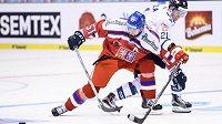 Český útočník Roman Horák a Toni Rajala z Finska během utkání turnaje Carlson Hockey Games.