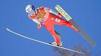 Norský skokan na lyžích Kenneth Gangnes na můstku v Planici.