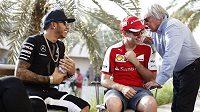 Lewis Hamilton, Sebastian Vettel a Bernie Ecclestone.