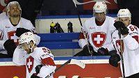 Zklamaní švýcarští hokejisté po prohře s Kanadou.