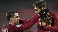 Zleva Ondřej Zahustel, Bogdan Vatajelu a Josef Šural ze Sparty se radují z gólu v duelu s Mladou Boleslaví.