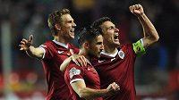 Hráči Sparty Bořek Dočkal, Lukáš Vácha a David Lafata (zleva) oslavují první gól během derby na Slavii