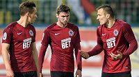 Fotbalisté Sparty (zleva) Josef Šural, Jiří Kulhánek a Lukáš Štetina po remíze v Teplicích.