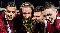 Fotbalisté Sparty Praha Dávid Hancko, Matěj Hanousek, Michal Trávník a Ladislav Krejčí oslavují vítězství a zisk trofeje po finále MOL Cupu v Liberci.