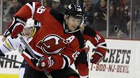 New Jersey Devils left wing Patrik Elias, front, of the Czech Republic, skates with the puck as Buffalo Sabres right wing Matt D'Agostinin falls during the second period of an NHL hockey game, Saturday, Nov. 30, 2013, in Newark, N.J. (AP Photo/Julio Cortez)
