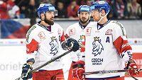 Hokejisté české reprezentace (zleva) Milan Gulaš, Martin Zaťovič a Jakub Jeřábek během utkání s Finy v Plzni.