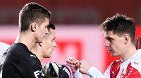 Brankář Slavie Praha Matyáš Vágner a Lukáš Masopust během utkání s Opavou.