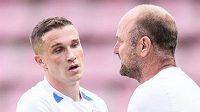 Příště to bude lepší... Tomáš Malinský ze Slovanu Liberec a trenér Pavel Hoftych během utkání na Spartě.