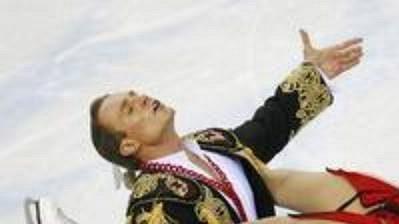 Olympijští vítězové v tancích na ledě Taťána Navková a Roman Kostomarov z Ruska při volné jízdě.
