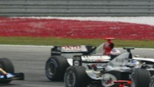 Michael Schumacher v čele závodu VC Malajsie