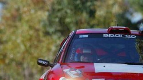 Finský pilot Grönhölm s Peugeotem 206 na trati Australské rallye.