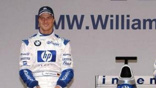 Piloti Ralf Schumacher (vlevo) a Juan Pablo Montoya při odhalení nového monopostu týmu BMW WilliamsF1.