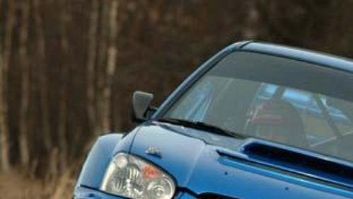 Roman Kresta se spolujezdcem Petrem Grossem při testech Subaru Impreza WRC S9.