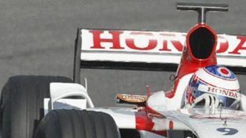 Jenson Button v kokpitu monopostu Honda 006.
