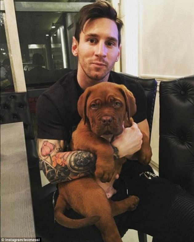 Lionel Messi se svým novým psem.