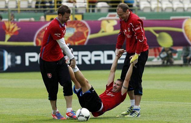 Jan Rezek a brankáři Jan Laštůvka a Jaroslav Drobný na tréninku českého týmu
