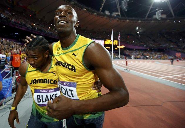 Yohan Blake (vlevo) letos dokázal Usaina Bolta porazit. V Londýně se ale před svým tréninkovým parťákem musel sklonit.