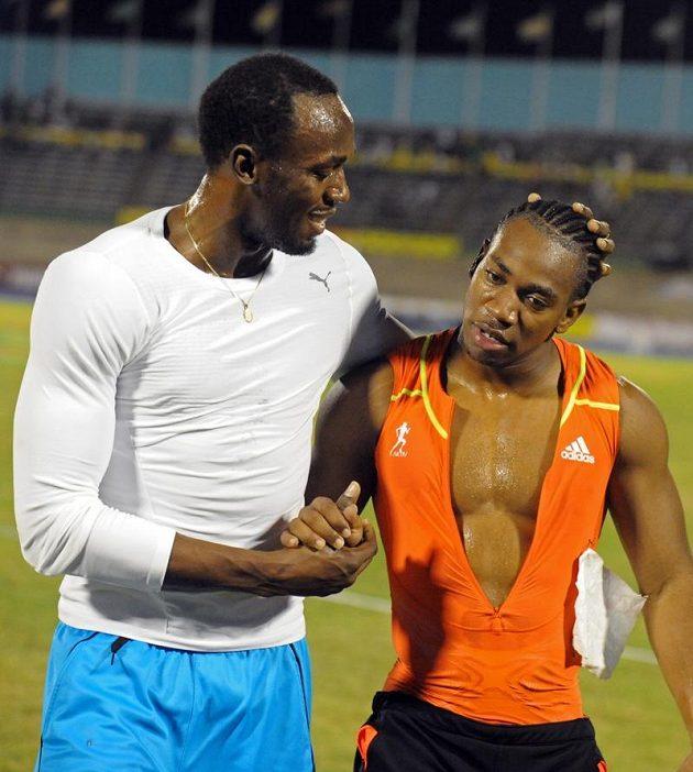 Velcí kamarádi, ale také soupeři. Jamajští sprinteři Usain Bolt (vlevo) a jeho krajan Yohan Blake jsou považováni za největší favority olympijské stovky