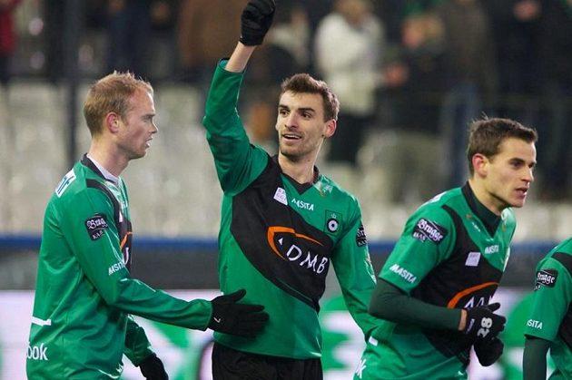Grégory Mertens (uprostřed) se spoluhráči.