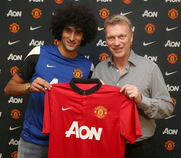 Záložník Marouane Fellaini (vlevo) a kouč Manchesteru United David Moyes.